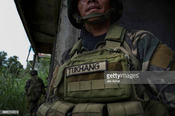 Soldiers take positions while they try to clear the city of armed militants one street at a time on May 25 2017 in Marawi city southern Philippines...