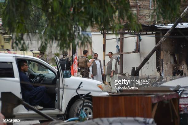 Soldiers take security measures after suicide and armed attack targeted administration of finance building in Jalalabad Afghanistan on May 13 2018 At...