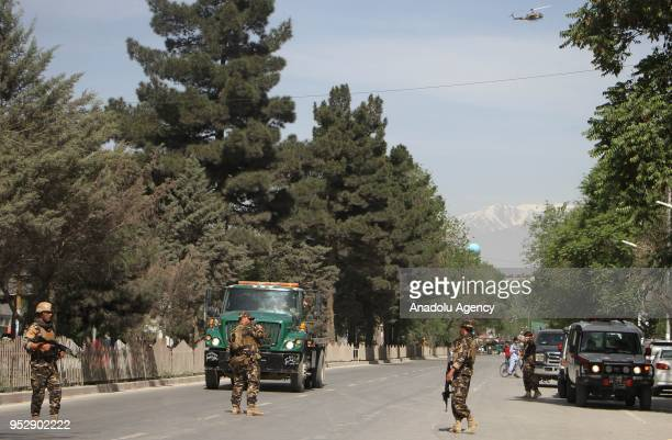 Soldiers take security measures after twin explosions targeted central Kabul Afghanistan on April 2018 At least 21 people were reported dead and 27...