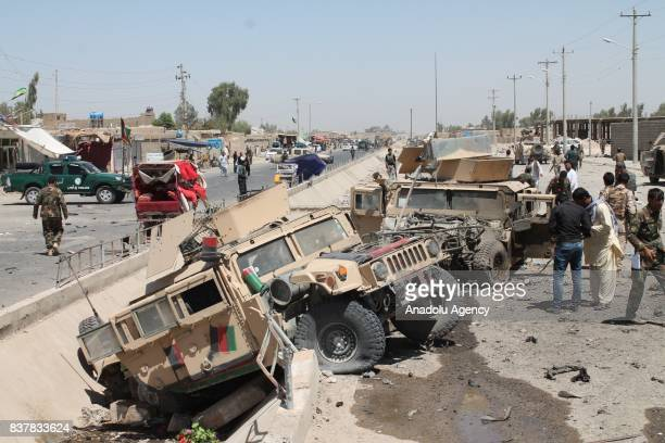 Soldiers take security measures around a group of wrecked armored vehicles after a suicide attack which had conducted with a bombladen vehicle to a...