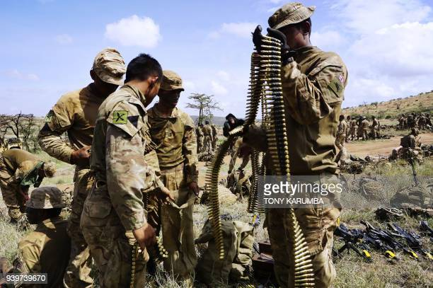 Soldiers take stock of ammunition during a simulated military excercise of the British Army Training Unit in Kenya together with the Kenya Defence...