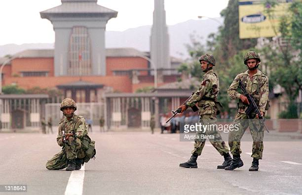 Soldiers take up positions in front of the Royal Palace June 4 2001 during a citywide curfew in Katmandu Nepal King Gyanendra the brother of slain...