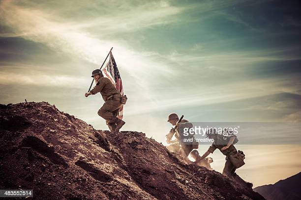 wwii soldiers taking a hill - army soldier stock photos and pictures