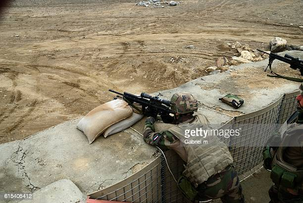 soldiers targeting from covered position - afghanistan war stock pictures, royalty-free photos & images