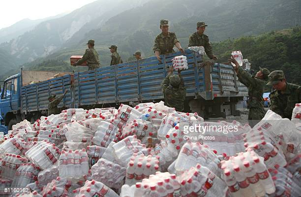 Soldiers transport rescue goods at Yingxiu Township the earthquake epicentre as China begins three days of national mourning for victims of the...