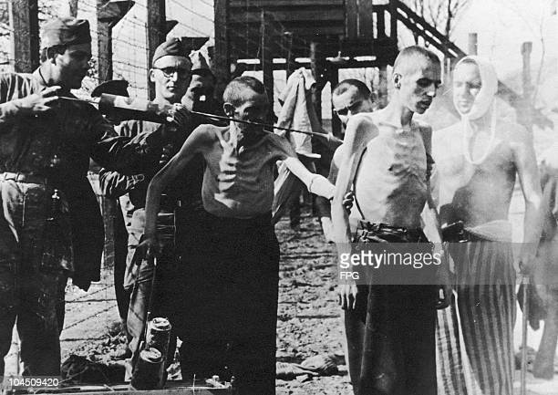 Soldiers treating Jewish captives at Mittelgladbach Camp after the camp was captured by the Allies, World War II, circa 1945.