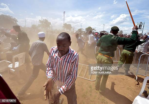 Soldiers try to control supporters of Kenya's President Uhuru Kenyatta and of his deputy William Ruto as they overrun a security barricade to get...