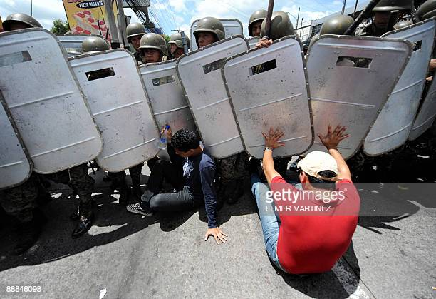 Soldiers try to remove supporters of Honduras' ousted President Manuel Zelaya from the streets in the surroundings of Tegucigalpa's international...