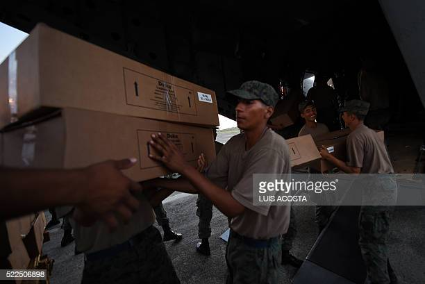 Soldiers unload food from an airplane at a military base for its distribution in Manta Ecuador on April 19 three days after a powerful quake hit the...