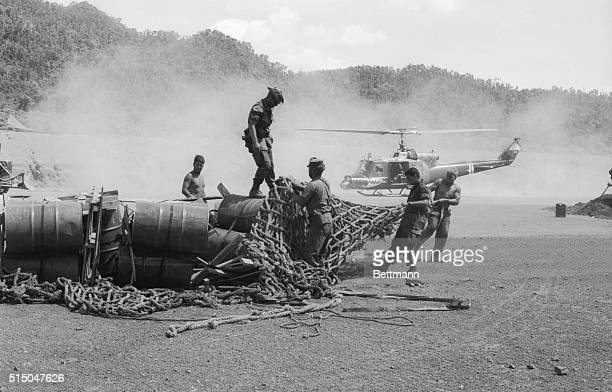 US soldiers unload supplies at a new combat base built some 15 miles from the Laotian border The site is an abandoned US Special Forces camp overrun...