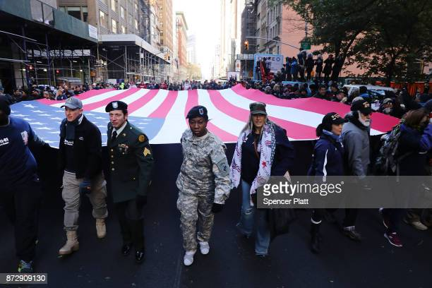 Soldiers veterans and civilians march the Veterans Day Parade on November 11 2017 in New York City The largest Veterans Day event in the nation this...