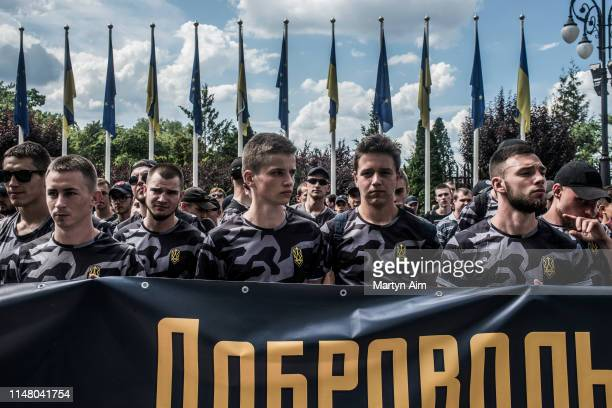 Soldiers, veterans and supporters of Azov Battalion hold a protest at the Ukrainian parliament to demand Ukrainian citizenship for their foreign...