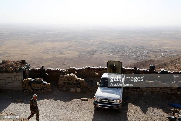 Soldiers wait at Mount Zertik as Peshmerga forces attack Daesh positions with howitzers at the entrance of the entrance of the Mosul in Nineveh Iraq...