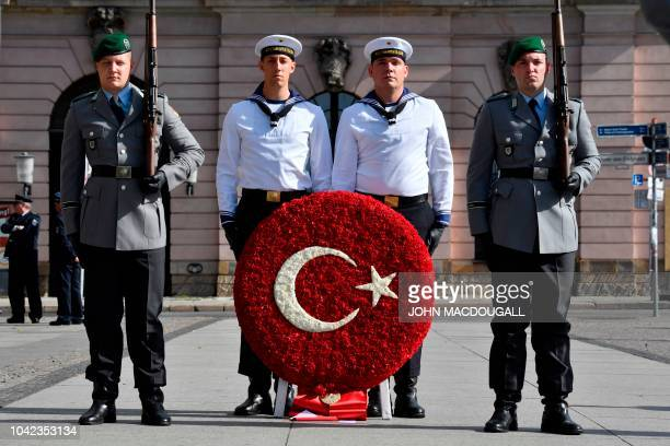 Soldiers wait at the Neue Wache memorial for the victims of war and dictatorship ahead a wreath laying ceremony of the Turkish President on September...
