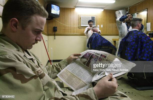 Soldiers wait for a haircut at Al Jaber Air Base in Kuwait American troops and equipment are massed in Kuwait in readiness for a possible war against...