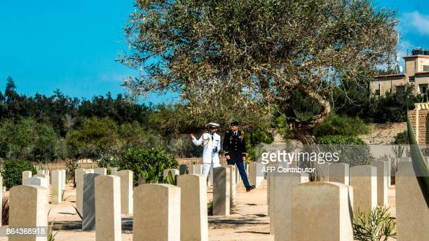 Soldiers walk amongst the Allied tombstones at El Alamein War Cemetary during a ceremony marking 75 years since the pivotal WWII battle in the...