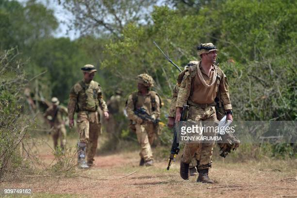 Soldiers walk as they prepare for an overnight simulated military excercise of the British Army Training Unit in Kenya together with the Kenya...