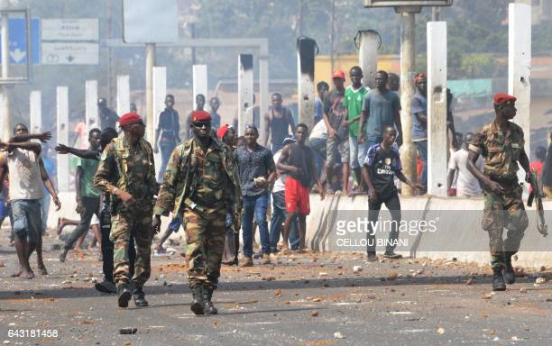 Soldiers walk in a street during a protest of teachers asking for wage increase and more hiring on February 20 2017 in Conakry BINANI