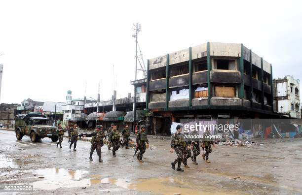 Soldiers walk through a battle damaged street in Marawi City in the Southern Philippines on October 17 2017 President Rodrigo Duterte on Tuesday...
