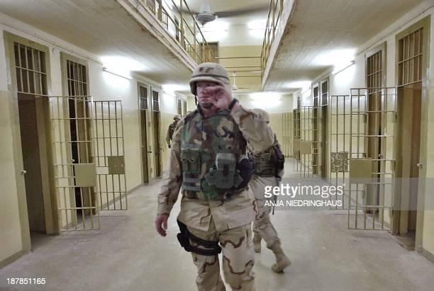 Soldiers walk through the halls inside the prison of Abu Ghraib, outside Baghdad, 05 May 2004. US Maj. Gen. Geoffrey Miller, commander of US-run...