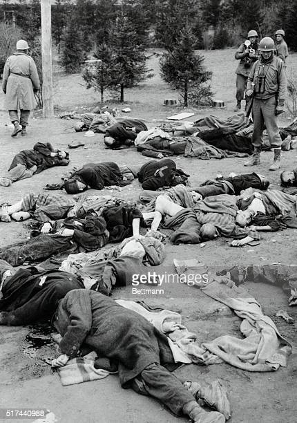 Soldiers walking among dead bodies at the Ohrdruf Concentration Camp in Germany | Location Ohrdruf Germany