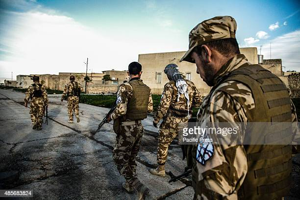 Soldiers walking around inside the village There are around 65 Christians pledged to fight alongside Peshmerga soldiers to protect the village of...