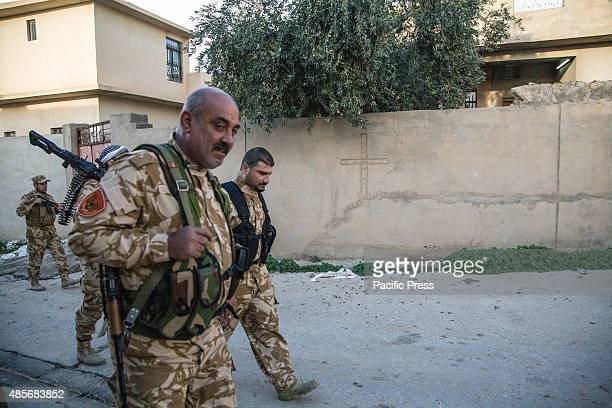 Soldiers walking inside the village There are around 65 Christians pledged to fight alongside Peshmerga soldiers to protect the village of Baqubah in...
