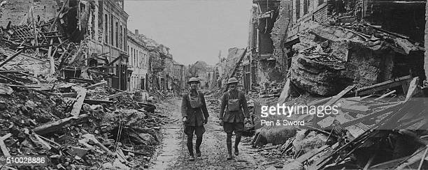soldiers walking through damaged streets France