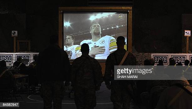 US soldiers watch a video transmission during the Super Bowl football championship at the Bagram Airbase some 50 kms north of Kabul in the early...
