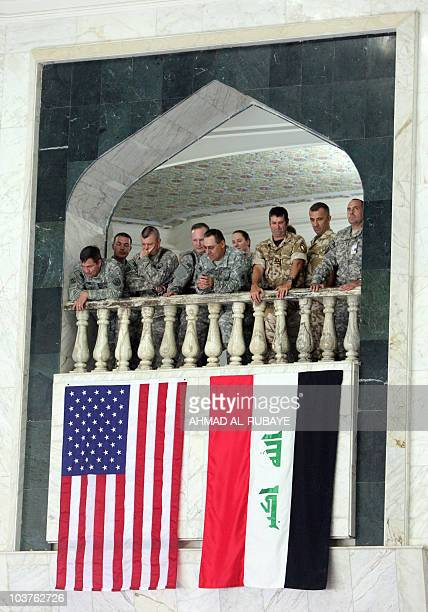 US soldiers watch the United States ForcesIraq change of command ceremony in Baghdad on September 1 as a new US military mission in Iraq was launched...