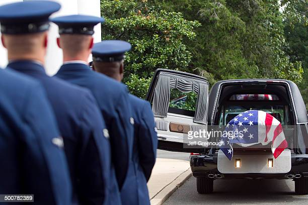 soldiers watching casket at military funeral - hearse stock photos and pictures