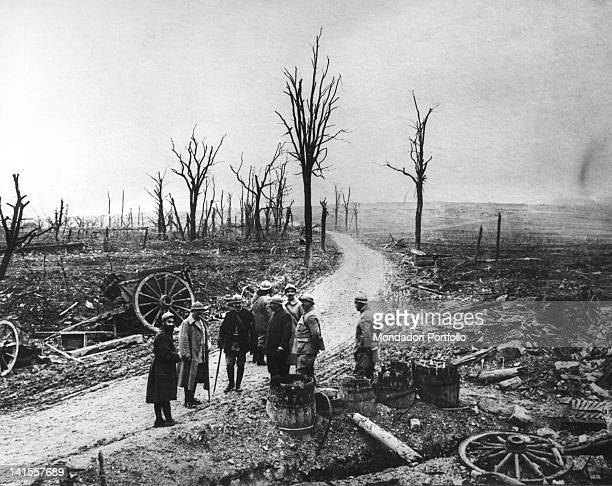Soldiers watching skeletal trees ruins and rubble at the end of the Battle of Verdun Verdun December 1916