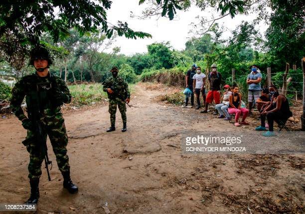 Soldiers wear face masks as a preventive measure against the spread of the new coronavirus, COVID-19, as they stand guard in Cucuta, Colombia, on the...
