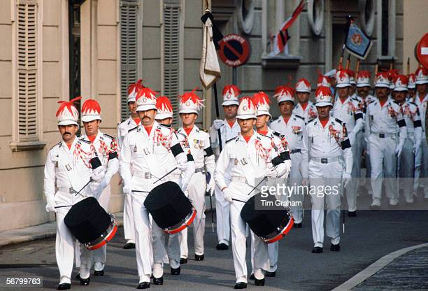 Soldiers wearing black armbands beat black muffled drums for mourning at the funeral of Princess Grace of Monaco