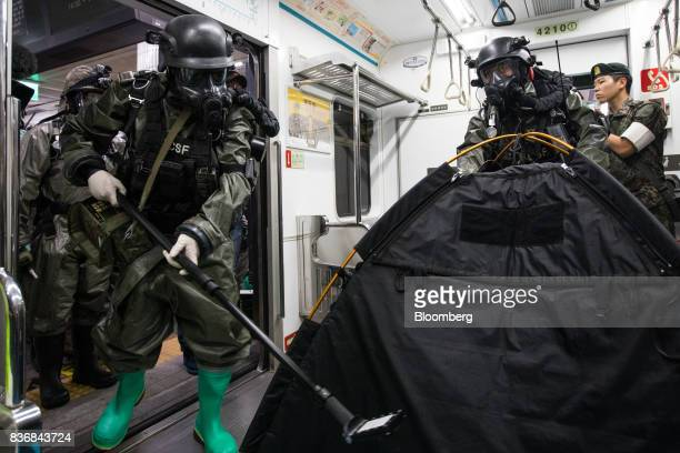 Soldiers wearing gas masks perform inspections inside a subway train during an antiterror drill on the sidelines of the Ulchi Freedom Guardian...
