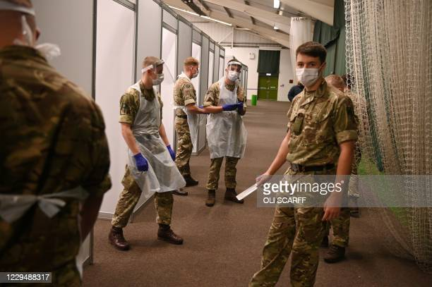 Soldiers wearing PPE prepare for the arrival of members of the public inside the mass and rapid testing centre for the novel coronavirus COVID-19 at...