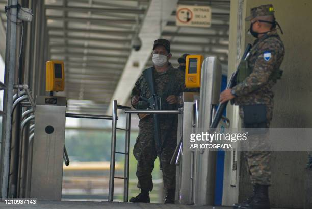 Soldiers wearing protective masks guard a bus station on April 24, 2020 in San Salvador, El Salvador. As the COVID-19 pandemic spreads globally...