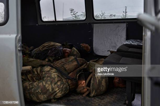 Soldiers who had been killed fighting for Azerbaijan lie in a van on the road where the final days of battle had unfolded between the two armies, on...