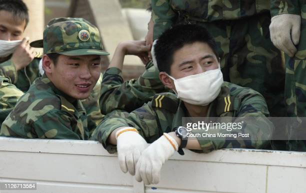 PLA soldiers who have been helping in the construction leave the entrance of the Xiaotangshan hospital north of Beijing The hospital has been built...