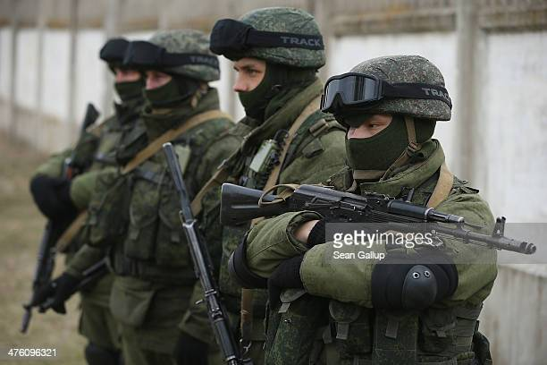 Soldiers who were among several hundred that took up positions around a Ukrainian military base stand near the base's periphery in Crimea on March 2...