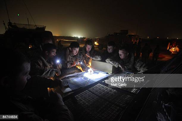 Soldiers with 1 Logistic Support Regiment are briefed on the night convoy route they will be taking from the main British base at Basra Airport to...