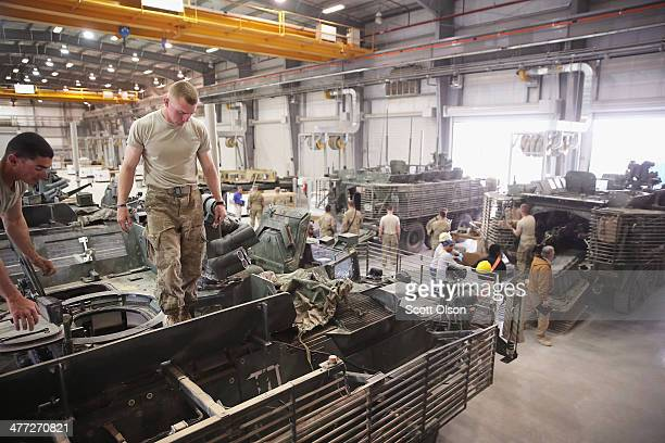 Soldiers with 4th Squadron 2d Cavalry Regiment turn in their Stryker vehicles to the Redistribution Property Accountability Team facility at Kandahar...