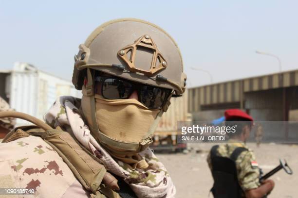 Soldiers with a military coalition in Yemen backed by Saudi Arabia and the United Arab Emirates stand guard at a facility of Yemen's Red sea mills...