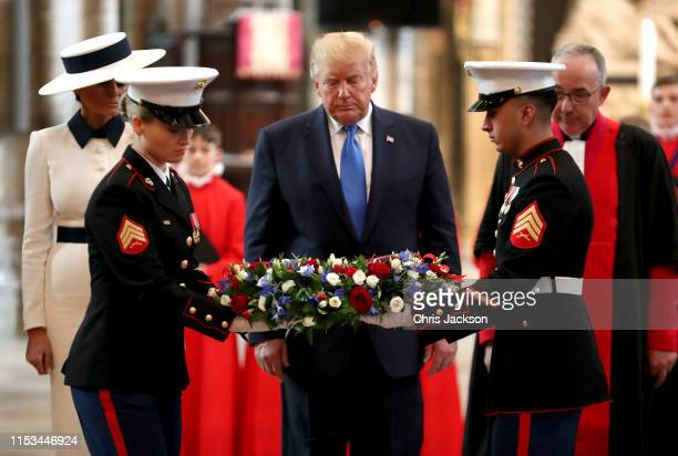 Soldiers with a wreath that US President Donald Trump and First Lady Melania Trump will lay at the Grave of the Unknown Warrior during their visit to...