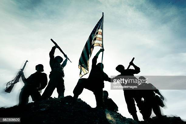 Soldiers with American flag.