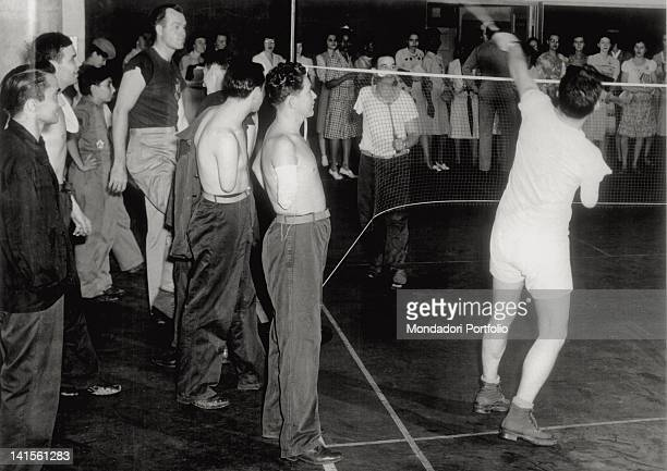 US soldiers with an amputee arm playing badminton in a reeducation centre Washington August 1945