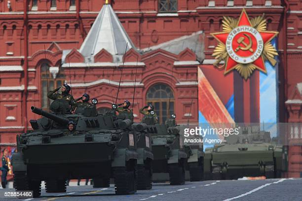 Soldiers with armored military vehicles are seen during the rehearsal of a military parade which will be held within the celebrations for the 9th of...