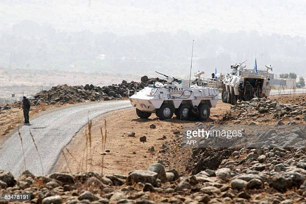 UN soldiers with armoured personnel carriers patrol a road in the southern border village of Wazzani close to the frontier betwen Lebanon and Israel...