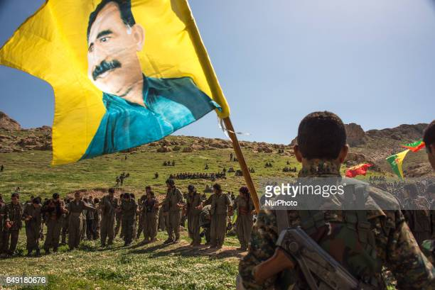 Soldiers with Kurdish militias in Sinjar, Iraq, celebrating the birthday of Abdullah Ocalan, a Kurdish nationalist leader and one of the founding...