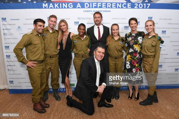 FIDF soldiers with L to R Joanna Krupa Gerard Butler Cheryl and Haim Saban at the FIDF Western Region Gala held at The Beverly Hilton Hotel on...